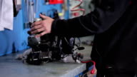 Mechanic turns the engine on the table video