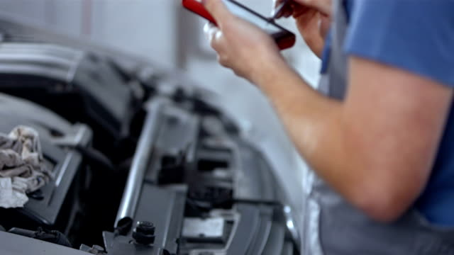 Mechanic Using A Diagnostic Tool video