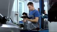 Mechanic Using A Digital Tablet video