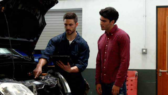 Mechanics overhauling an engine video