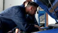 Mechanics repairing an engine video