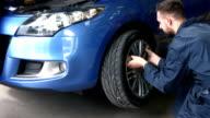 Mechanics working on a car video