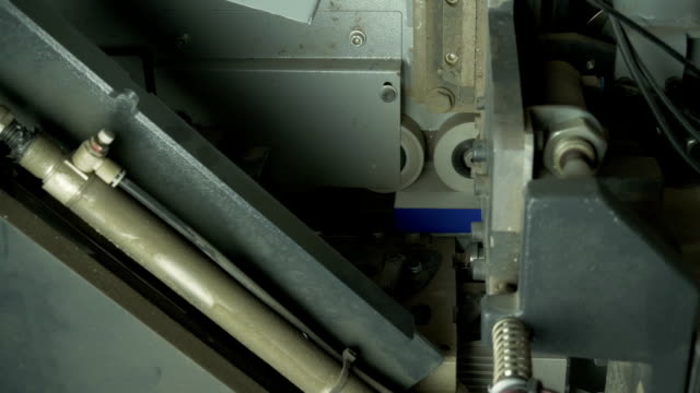 Mechanism of the machine sticking wooden plates. video