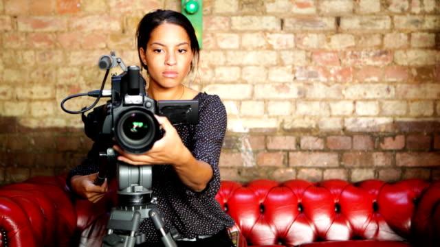media: attractive female camera operator video