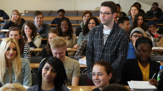 Media studies student speaks in lecture room video