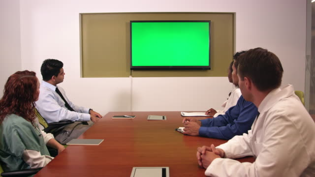 Medical and Business Professionals in Front of Chroma Key Monitor video
