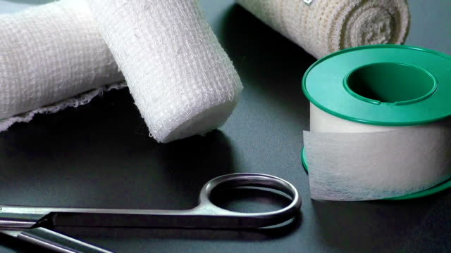 Medical bandages with scissors and sticking plaster video