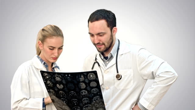 Medical collaboration examine xray and discuss patient problems on white background video