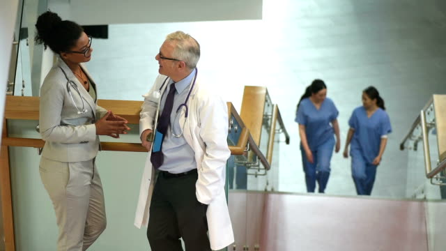 medical colleagues chatting in a stairwell of a hospital video