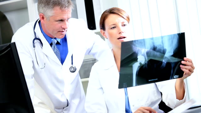 Medical Consultants Looking X-Ray Results video