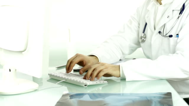 Medical Doctor Hands Typing on Keyboard PC Researching Concept video