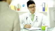 Medical Doctor Offering Apple to Patient video