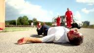 Medical emergency team arrives at street accident video