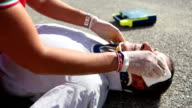 Medical emergency team first aid at street accident video