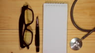 Medical forms with stethoscope empty. video