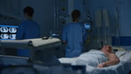 DS Medical nurses checking intensive care patient video