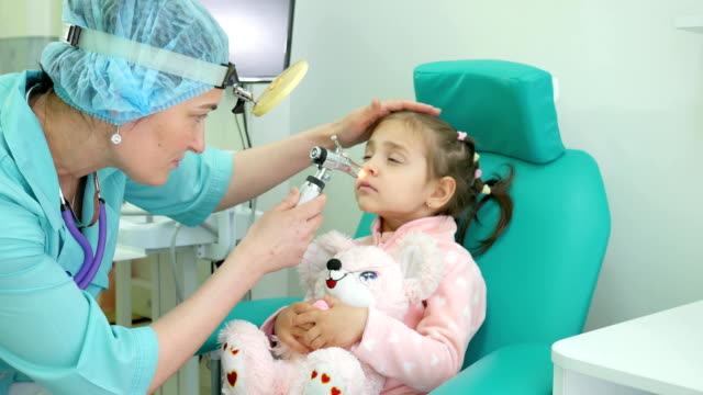 Medical procedure, otolaryngologist treats infant, Medical examination child, advice otolaryngologist in clinic, flu treatment of ENT diseases in infant, hospit video