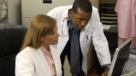 Medical Professionals Discuss Data Records - CU video
