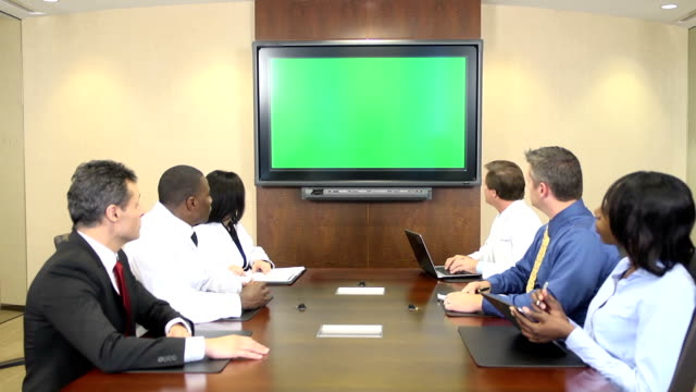 Medical Professionals Meet in Front of Chroma Key Monitor video