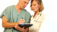 Medical Professionals using Digital Tablet video