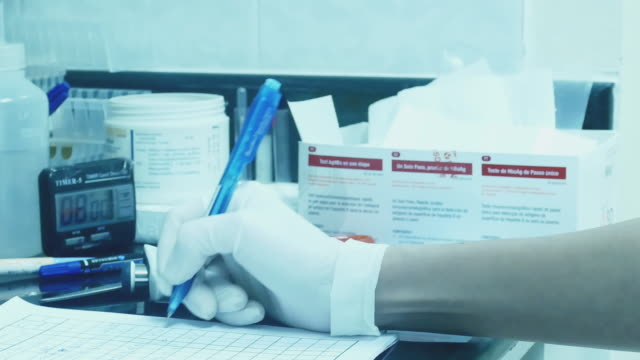 Medical researcher using pen writing notes video