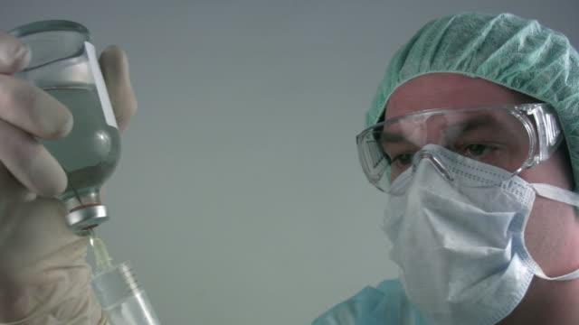 Medical scientist 'preparing syringe' video