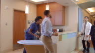 Medical Staff At Busy Nurses Station In Hospital Shot On R3D video