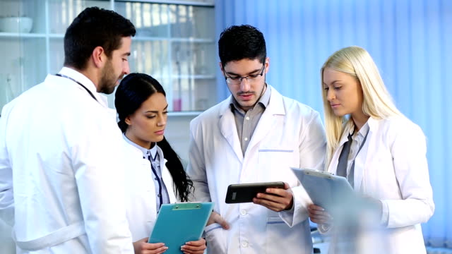 Medical staff discuss video