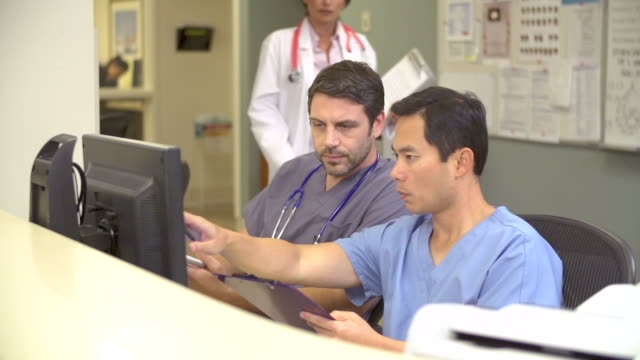 Medical Staff Working At Busy Nurses Station video