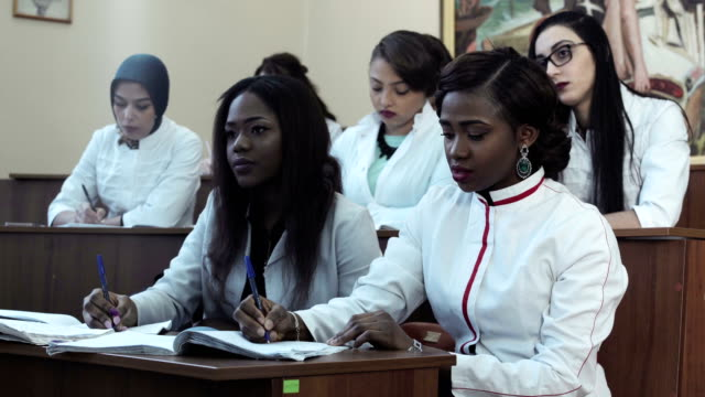 Medical students in lecture video