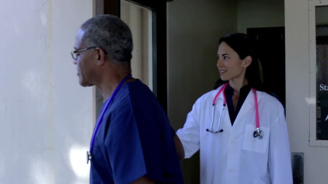 Medical Team Having Discussion Outdoors video