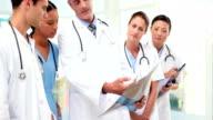 Medical team looking at Xray video