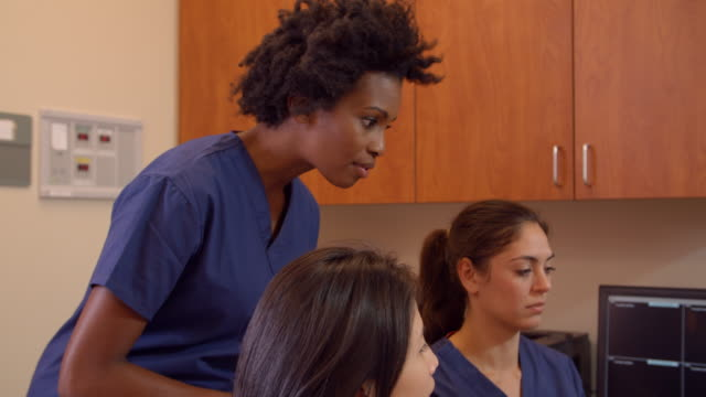 Medical Team Meet At Nurses Station In Hospital Shot On R3D video
