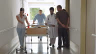 HD: Medical Team Moving Patient On A Gurney video