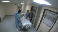 POV Medical team pushing stretcher with child along hallway video