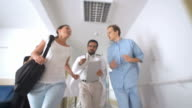 HD: Medical Team Rushing Down A Hallway video