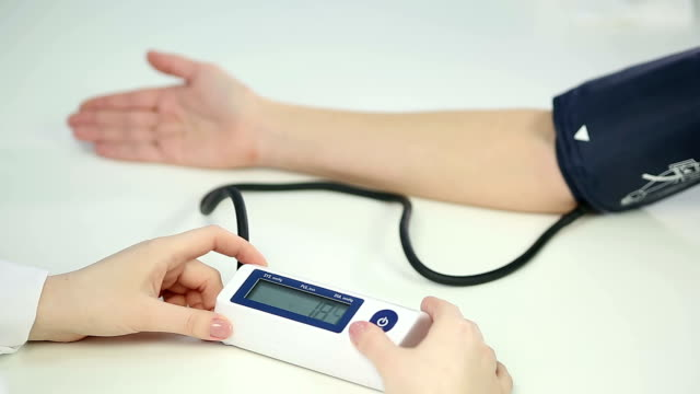 Medical worker monitoring blood pressure of patient diagnosed with hypotension video