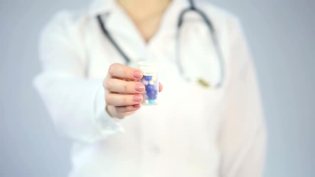 Medical worker recommending new effective pills, pharmaceutical industry product video