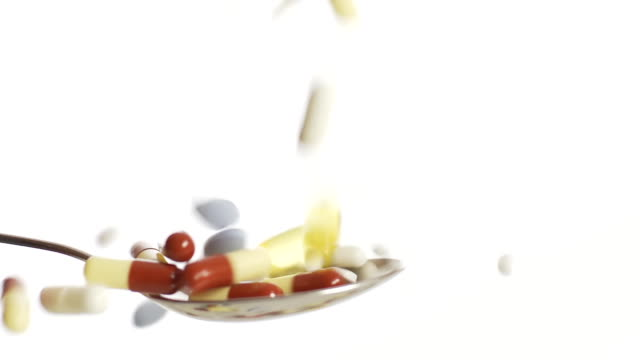 HD SLOW MOTION: Medicaments Falling On A Spoon video
