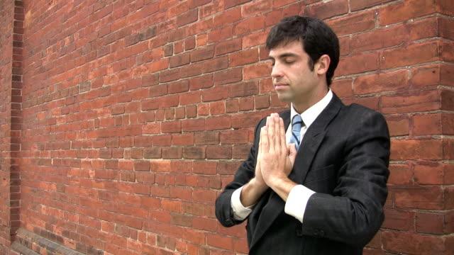 Meditating businessman. video