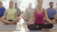 Meditating in Lotus Position during Yoga Class video