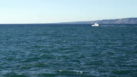 Mediterranean sea in Marseille on a windy day with swirl and boat video