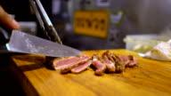 medium roast rib-eye steak on wooden plate video
