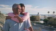 Medium Shoot of Happy African American Couple Embrace near Beach video