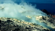 Medium time-lapse shot of Sicilian Egadi Volcano's island fumarole releasing white steam video