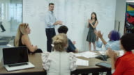 Meeting Attendees in Creative Office Space Applauding video