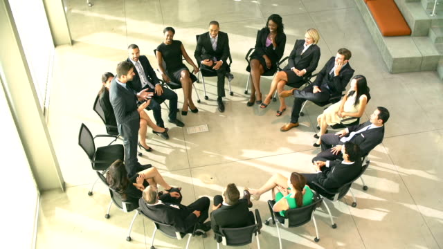 Meeting With Businesspeople Sitting In Circle On Chairs video