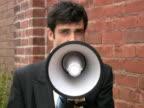 Megaphone businessman. 2 shots. video