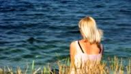 HD: Melancholic Woman On The Beach video