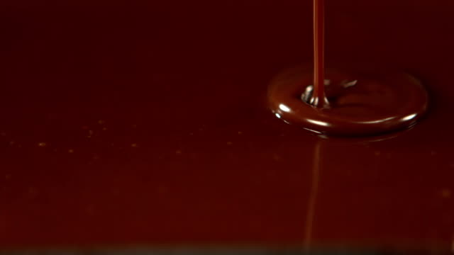 Melted chocolate pouring over almonds video